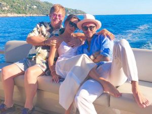 Elton John, Victoria Beckham, and David Beckham relaxing on a yacht