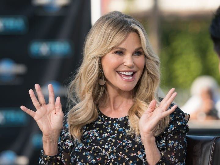 "Christie Brinkley visits ""Extra"" at Universal Studios Hollywood on January 18, 2018 in Universal City, California."