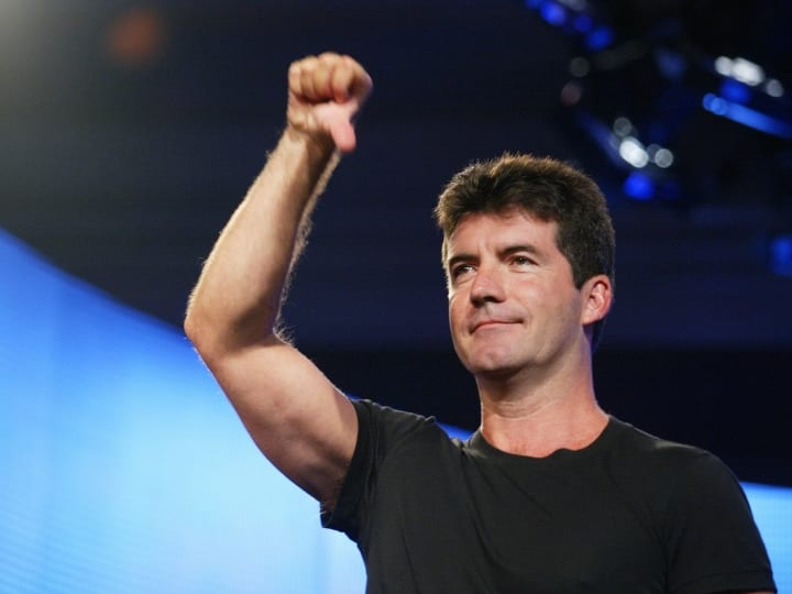 American Idol judge Simon Cowell demonstrates his style for the press at the FOX 2002 SummerTCA Tour at the Huntington Ritz Carlton Hotel in Pasadena, CA on Monday, July 22, 2002.