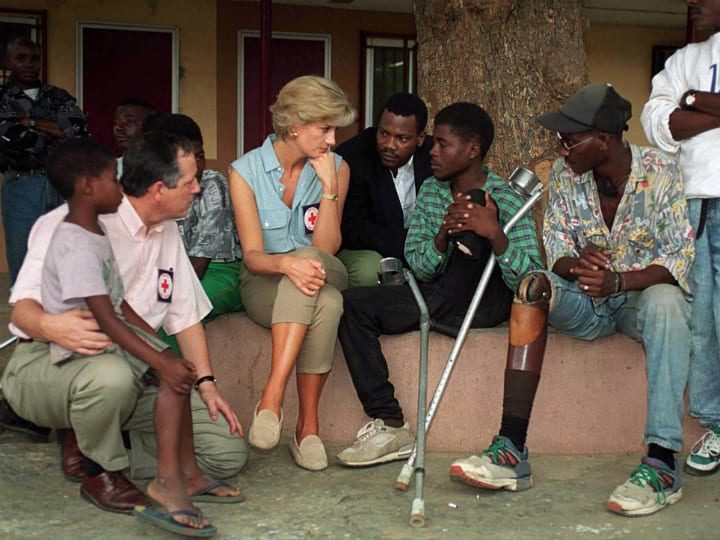 Princess Diana doing charity work in Africa