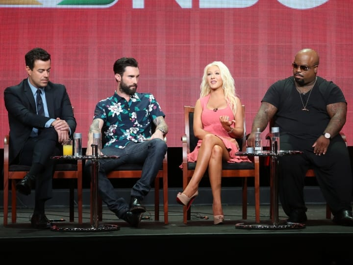 "BEVERLY HILLS, CA - JULY 27: (L-R) Producer/Host Carson Daly and coaches Adam Levine, Christina Aguilera, and CeeLo Green speak onstage during ""The Voice"" panel discussion at the NBC portion of the 2013 Summer Television Critics Association tour - Day 4 at the Beverly Hilton Hotel on July 27, 2013 in Beverly Hills, California."