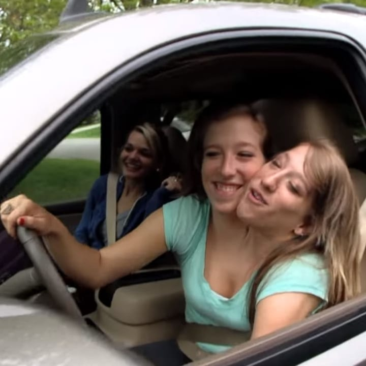 driving a car, Brittany and Abby, conjoined twins