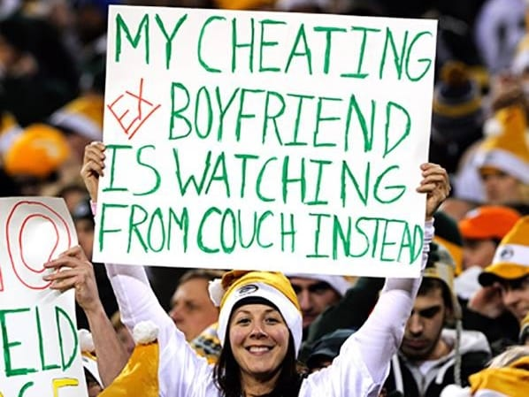 Cheater, football, holding a sign