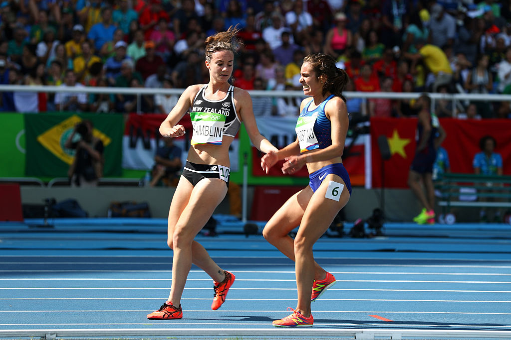 RIO DE JANEIRO, BRAZIL - AUGUST 16:  Abbey D'Agostino of the United States (R) is assisted by Nikki Hamblin of New Zealand after a collision during the Women's 5000m Round 1 - Heat 2 on Day 11 of the Rio 2016 Olympic Games at the Olympic Stadium on August 16, 2016 in Rio de Janeiro, Brazil.