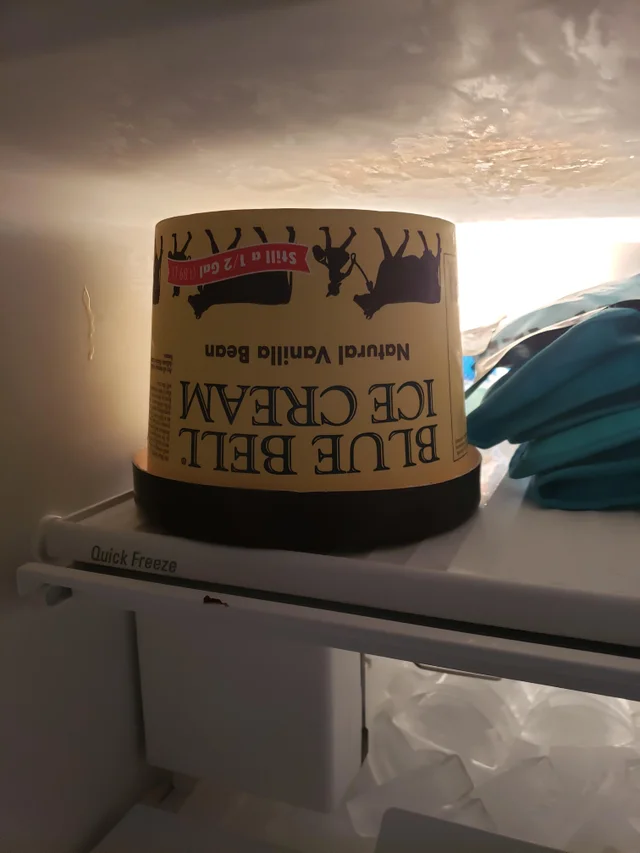 Ice cream sits upside down in a freezer