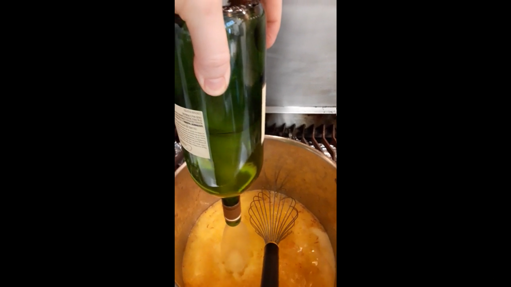 A tornado forms in a bottle held upside down and poured into a pot of soup