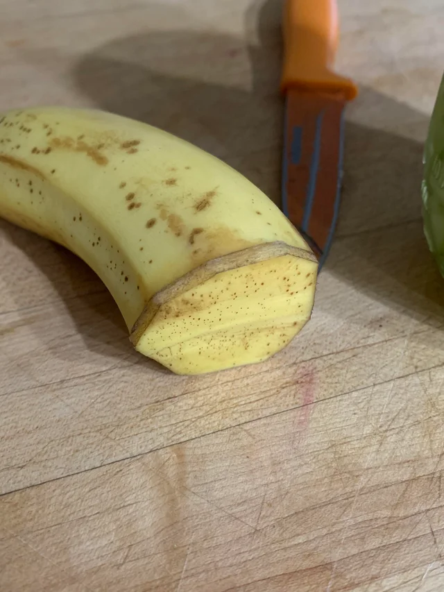 Half a banana is sealed using the banana peel from part that has been used
